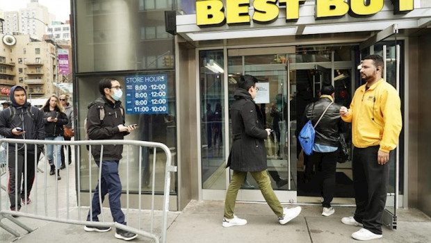 ep march 19 2020 - new york ny usa an employee takes count of how many customers are entering the