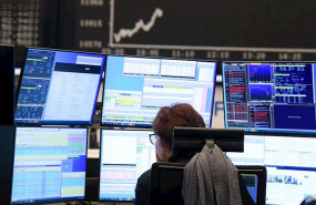 ep main a stock trader watches her monitors on the trading floor of the frankfurt stock exchange